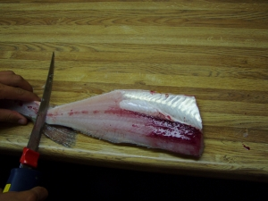 Cleaning A Walleye Using An Electric Knife